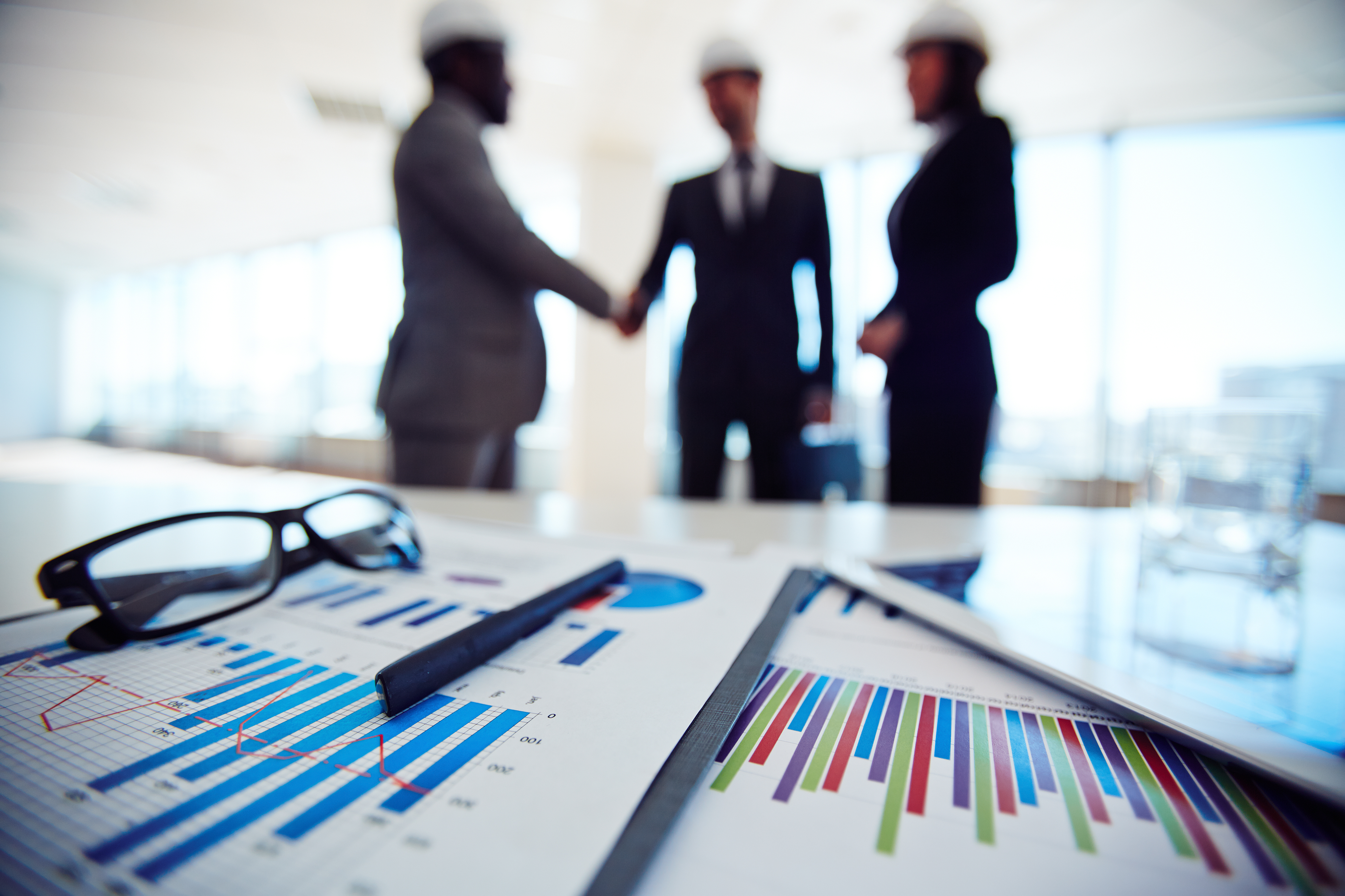Business documents on background of three business partners